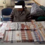 Tigari si sticle cu alcool netimbrate, confiscate de inspectorii vamali